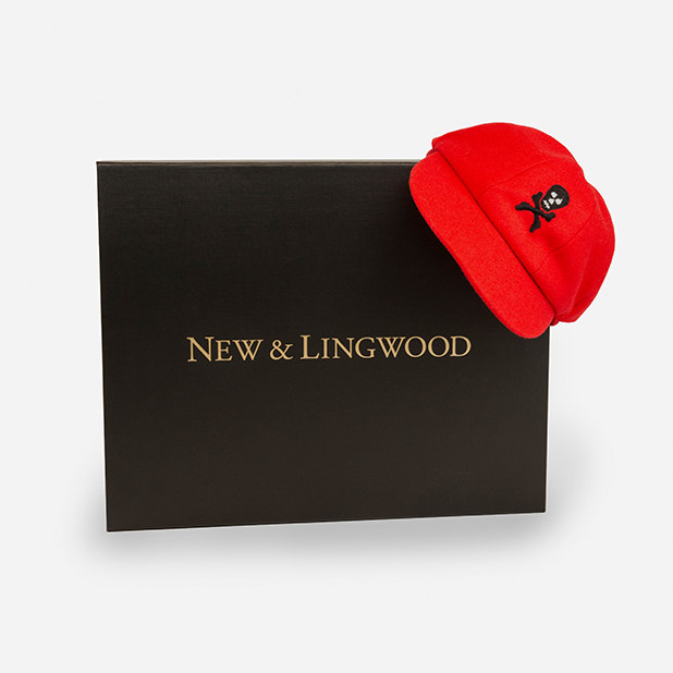 red hat with skull and cross bones on packaging box – New & Lingwood – point one percent