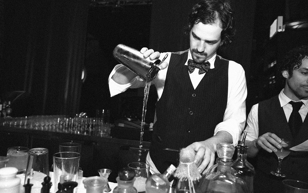 bartender pouring cocktail in black and white – Purity Vodka – point one percent